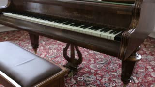 Old piano in the living room. Home interior walk through living room.