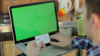 Online shopping on a laptop computer. Green screen, chroma key