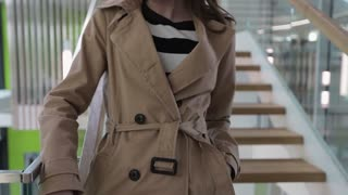Portrait of a Beautiful Young Woman. Young stylish girl in a brown coat