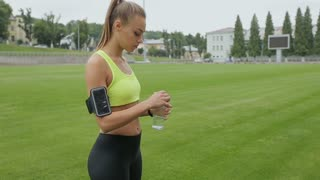 Runner stops to take a break and to drink water