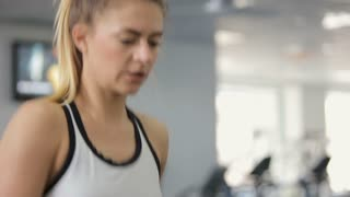 Super fit woman running on the treadmill at the gym