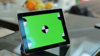 Tablet with Green Screen Staying on a Table. Easy to tracking and keying.