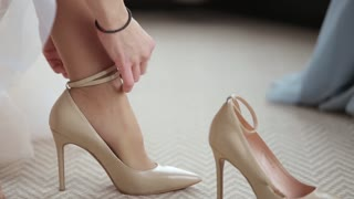 the bride wears wedding shoes