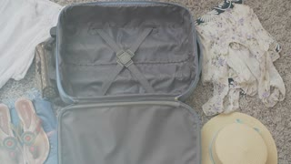Top view packing vintage suitcase girls planning road trip