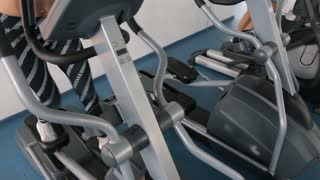 Walking Machine - a woman exercising in the gym