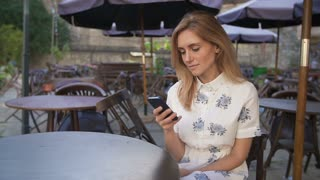 Woman using smartphone in Coffee Shop.