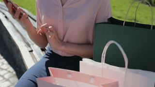 Woman with shopping bags talking on her phone