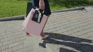 Woman with shopping bags walking in a city. Close up