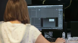 Woman working at office architectural plans with a cad software