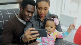 Young african american family make selfie on smartphone