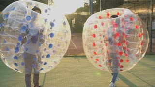 Young couple having fun on weekends. Play in battle with inflatable balloons