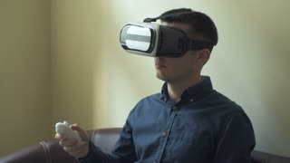 Young man using VR 360 and 3D technology