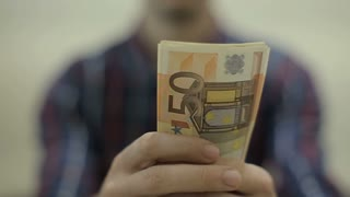 View of a man Counting Many American Euro 100 bills, Man not happy about not having enough money.Slowmotion