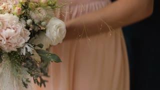 Wedding bouquet in hands of the bride.Beautiful wedding bouquet in hands of bride.Bride holds a wedding bouquet in her hands