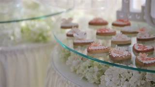 Wedding candy bar.Candy bar with cookies and colorful candy on plate for birthday, anniversary, wedding