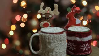 Woman photographing christmas drinks and christmas decorations.