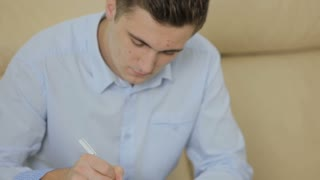 Young man fills form for patients in the dental clinic