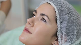 Young woman getting ultrasonic facial cleansing in cosmetology salon