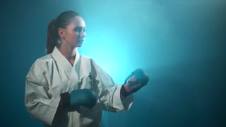 A karate girl making karate punches