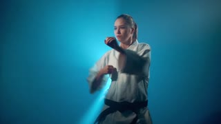 A karate girl punching