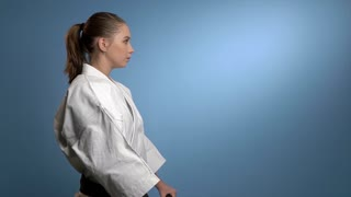 A karate woman fighting with nunchucks
