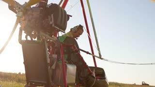 A pilot getting onto an ultralight trike, airplane