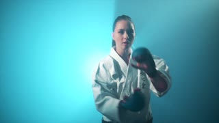 A woman making karate block punches