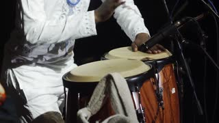 African musician in traditional clothes and drums