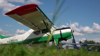 an old airplane on green grass