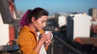 Asian woman enjoying her morning coffee