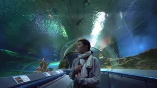 Asian woman tourist in oceanarium