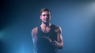 basketball player making tricks with a ball