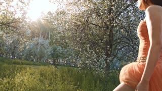 Beautiful Asian girl near a flowering tree