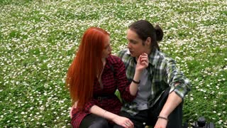 beautiful couple in love sitting in spring grass