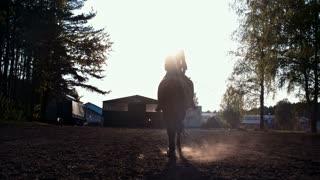 Beautiful girl  riding a horse against sun 6