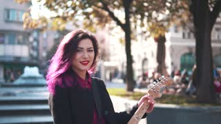 beautiful girl with electric guitar
