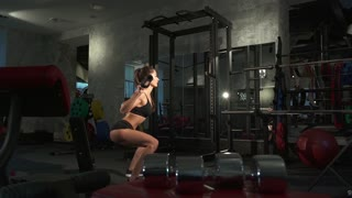 beautiful sporty sexy woman doing workout in gym