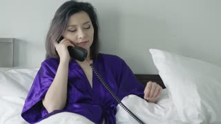 Beautiful Woman talking on broken phone