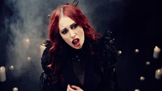 Beautiful Young woman as sexy vampire