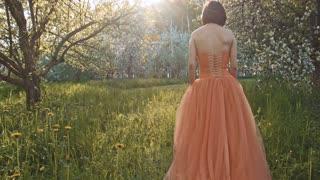 Beautiful young woman wearing elegant orange dress