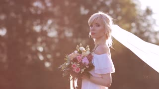 bride in a morning surrounding by golden sunlight