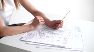 business woman working with drawings and papers
