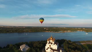 Colorful hot air balloon flying over Yaroslavl city