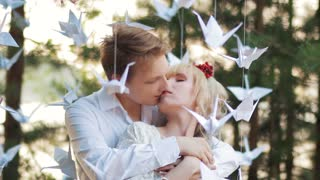 couple in love between origami birds