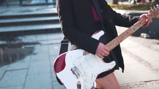 Crazy beautiful girl with electric guitar