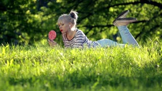 Cute girl with lollipop and music player
