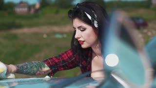 Erotic girl washing a car