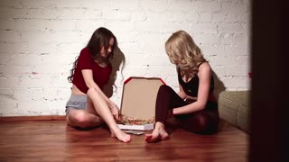 female girl friends eating pizza at home