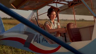 Female pilot in an old airplane