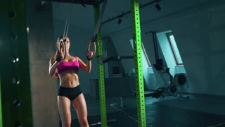 Fitness dip ring girl workout at gym